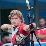 Brad shooting at the 2014 Youth Olympics, Nanjing.